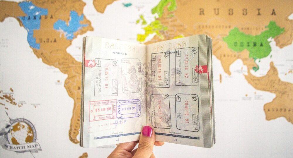 Passport-over-Map-Happy-to-Wander-1-1